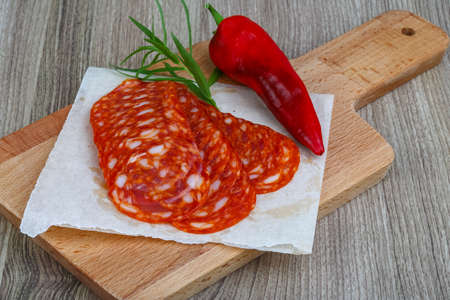 chorizo: Spanish traditional sausages - Chorizo - with estragon leaves and hot pepper Stock Photo