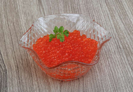 japanese cookery: Red caviar in the bowl with green parsley leaf Stock Photo