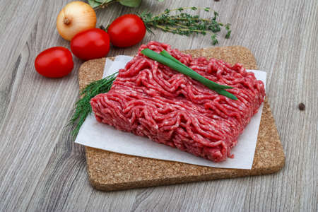 minced beef: Raw minced beef meat with green oinion and dill Stock Photo