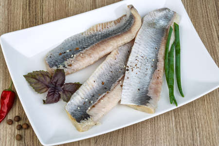 seafish: Herring fillet with green onion, basil leaves and pepper