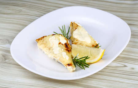 plaice: Baked perch fillet with rosemary and lemon