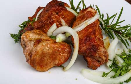 shashlik: Grilled pork meat - shashlik with onion rings and rosemary