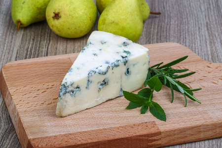 roquefort: Blue cheese with mint leaves, rosemary and pears