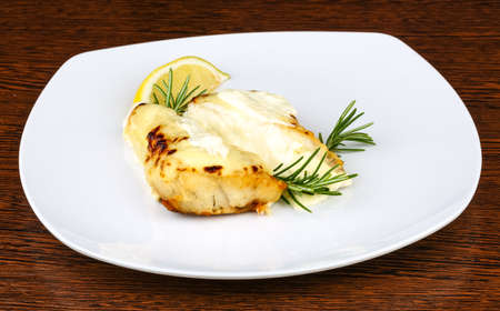 Baked perch fillet with rosemary and lemon