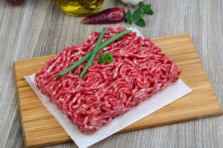 minced beef: Raw minced beef with onion and parsley - ready for cooking