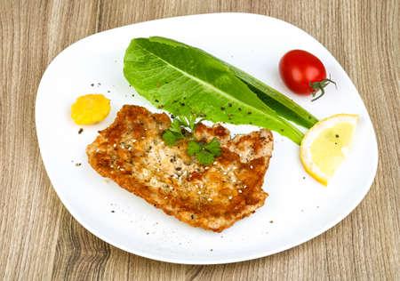 schnitzel: Pork schnitzel with sesame seeds, parsley and lemon Stock Photo