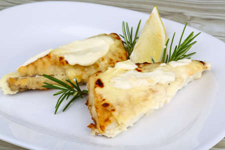 shark catfish: Baked perch fillet with rosemary and lemon