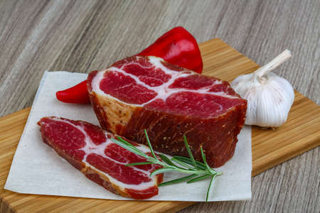 chuck: Chuck steak with rosemary, pepper and garlic on wood background Stock Photo