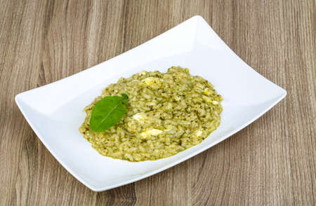 Risotto with pesto, ruccola leaf and soft cheese
