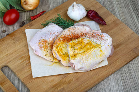 fat bird: Raw chicken thights with paprika, dill and garlik Stock Photo