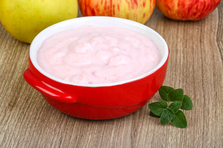 srawberry: Fresh cold Srawberry yoghurt on the wood background