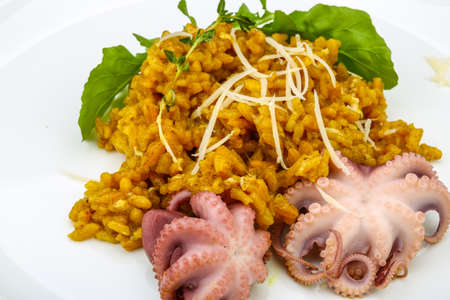 seafood: Seafood risotto with octopus, cheese and thyme leaf