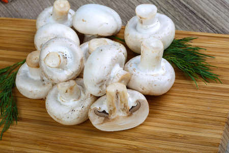 champignons: Fresh raw Champignons on the wood background served green dill
