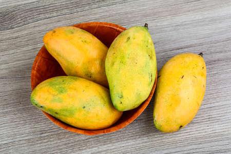 mango: Ripe yellow mango in the basket on wood background