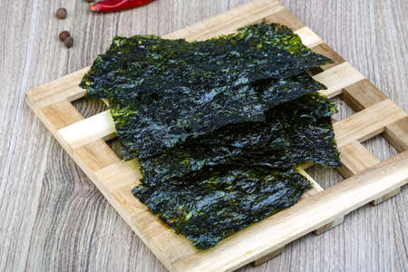 snack food: Korean traditional snack - Nori seaweed sheets on the wood background Stock Photo