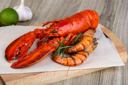 spiny lobster: Big cooked lobster and tiger shrimps ready for eating Stock Photo