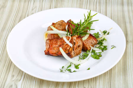 kabob: Hot Pork Shashlik with onion rings and spices