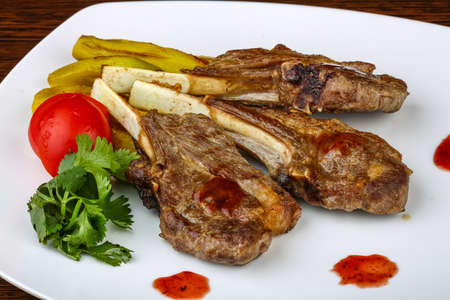 lamb meat: Grilled Lamb chops with eggplant and coriander leaves Stock Photo
