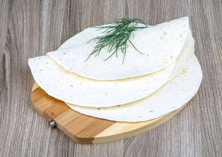 dill leaves: Mexican Tortillas with dill leaves on the wood background