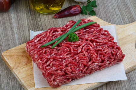 minced beef: Minced beef meat with onion on the wood background