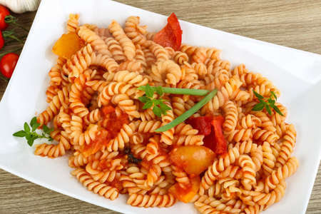 pasta: Pasta with tomato, green onion and basil leaves