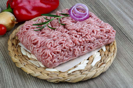 mincemeat: Raw minced pork meat with onion and rosemary ready for cooking