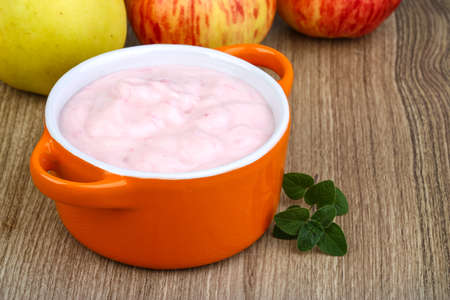 Fresh cold Srawberry yoghurt on the wood background