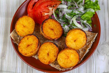 prepared potato: Baked potato - vegetarian barbeque - shashlik served onion rings and tomato