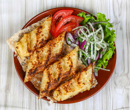 grilled potato: Grilled potato kebab served bread, tomato, salad and onion rings