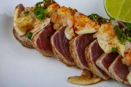 seared: Roasted Tuna steak weeth salad in the wood background Stock Photo