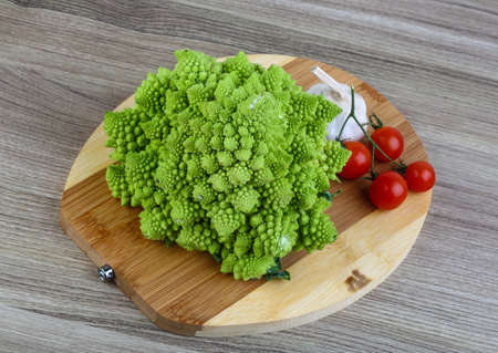 romanesco: Romanesco exotic cabbage on the wood background