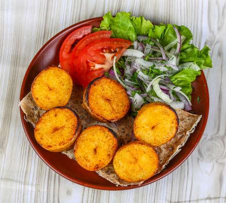 shashlik: Baked potato - vegetarian barbeque - shashlik served onion rings and tomato