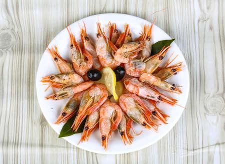 appetiser: Boiled shrimps snack - appetiser served lemon and olives Stock Photo