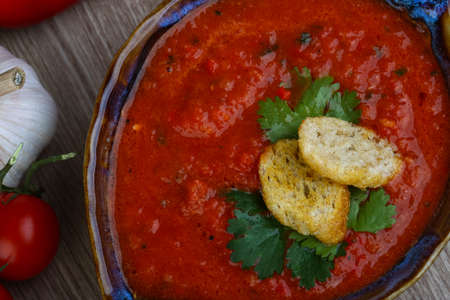 croutons: Spanish traditional soup - Gazpacho with croutons and parsley Stock Photo