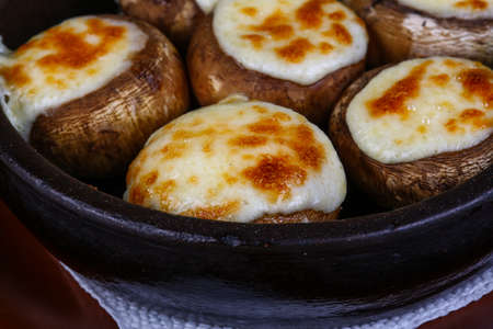 Baked Stuffed champignon with hard cheese and spices Reklamní fotografie
