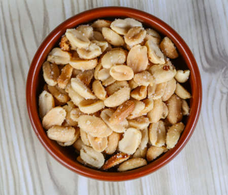 appetiser: Salted peanuts in the bowl - appetiser snack