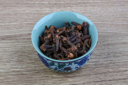 aromatic: Aromatic Dried Cloves seeds on the wood background