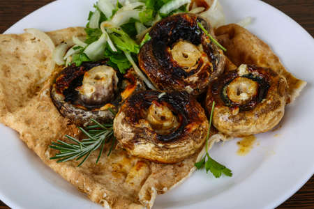 paleolithic: Baked champignons with rosemary and onion rings abd parsley