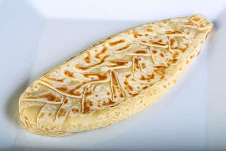 uzbek: Uzbek pie on the white plate Stock Photo