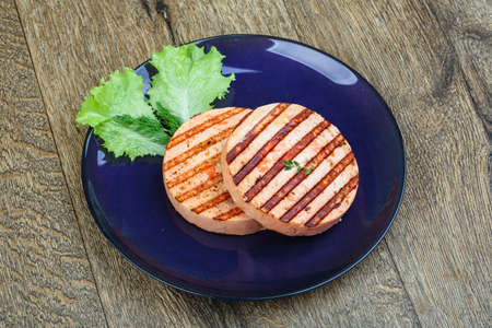 fresh food fish cake: Grilled fishcake for fishburger with salad leaves