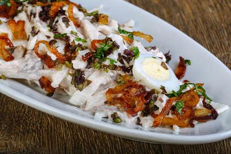 quail egg: Chicken salad with quail egg and onion
