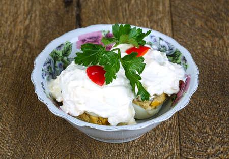 tuna mayo: Stuffed eggs with meet with sauce and parsley