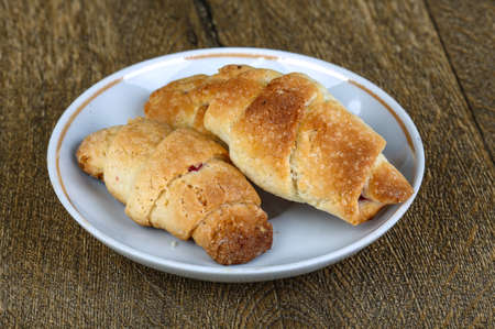 danish puff pastry: Pastry with jam for breakfast on the wood background