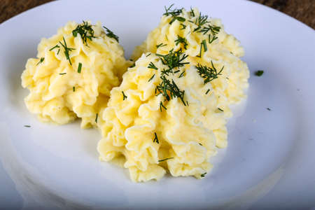 mash: Mash potato with dill on the white plate Stock Photo