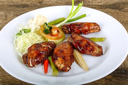 teriyaki: Teriyaki chicken wings with herbs and spices Stock Photo