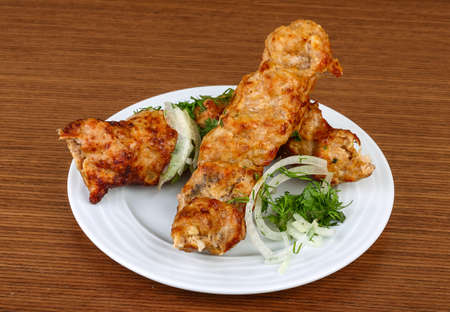 seekh: Grilled kebab meat with onion rings and parsley