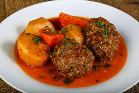 Minced meat balls with potato, carrots and sauce Stock Photo