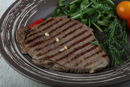 dill leaves: Grilled beaf steak with rucola and dill leaves