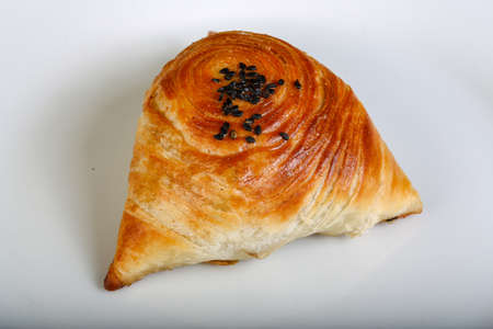 person appetizer: Uzbek traditional pastry - samsa with meat and spices