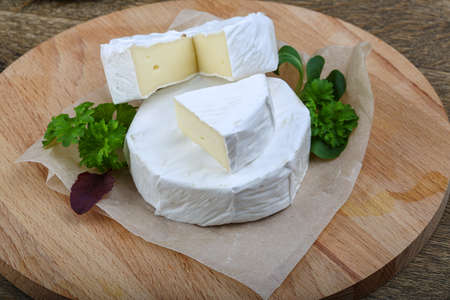camembert: Camembert cheese with parsley and salad leaves Stock Photo
